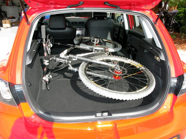 Mazdaspeed 3 has space for a full bike with the front seat down