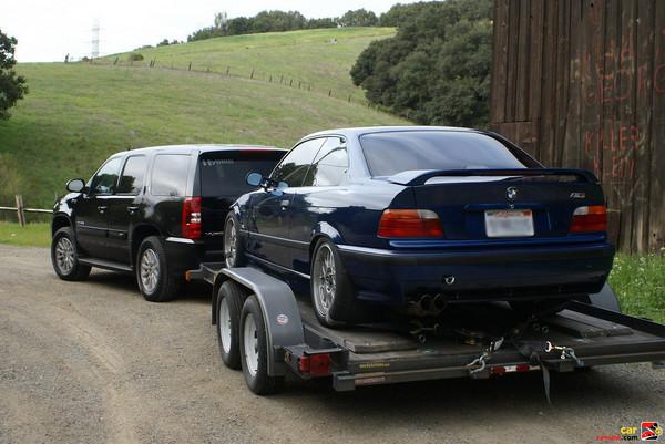 GMC Yukon Hybrid towing Tony's M3