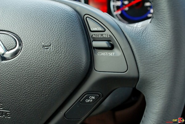 Leather-wrapped 3-spoke steering wheel with cruise controls