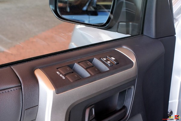 Power window and door lock switches mounted higher
