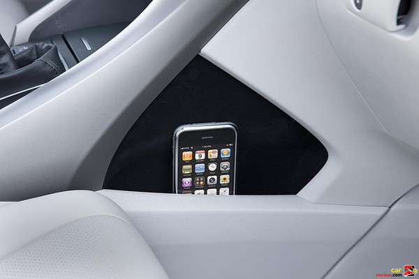 A cubbyhole on the side of the front center console