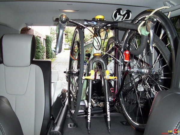 2 bikes, cooler, extra wheelset, luggage, and still able to fit 3 people in