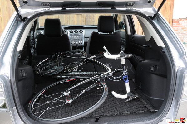 52cm road bike with room to spare. MTB likely fits  too