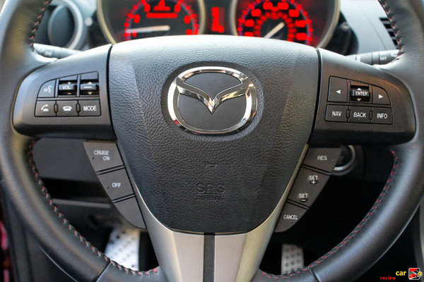 Steering wheel mounted audio and cruise controls