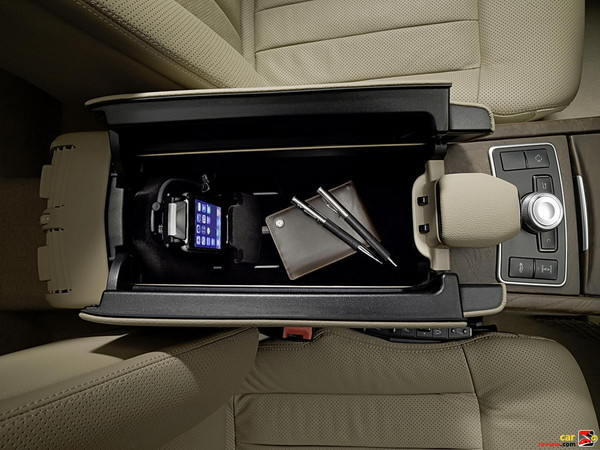 Under arm rest storage bin