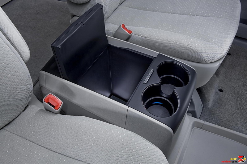 Sliding center console with illuminated storage compartment