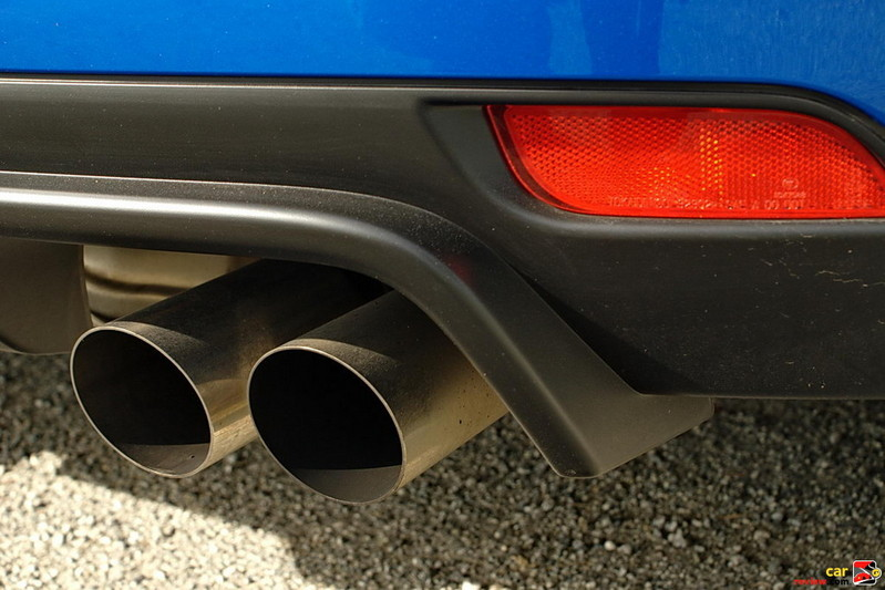 Exhaust system with quad outlets