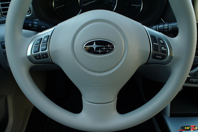 Audio and cruise controls mounted on steering wheel
