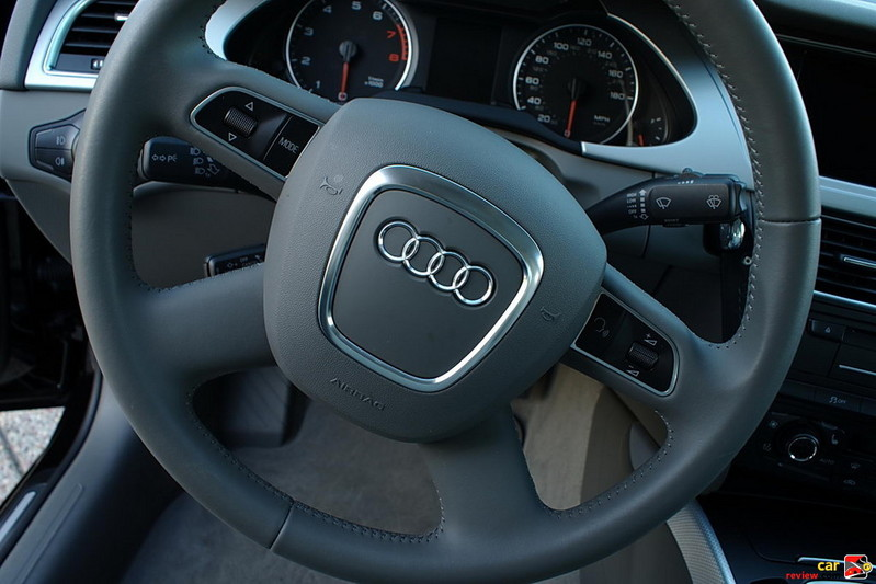 Four-spoke, multifunction, leather-wrapped steering wheel