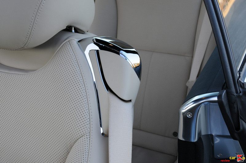 Chrome rear seat access lever and polished aluminum door jamb trim