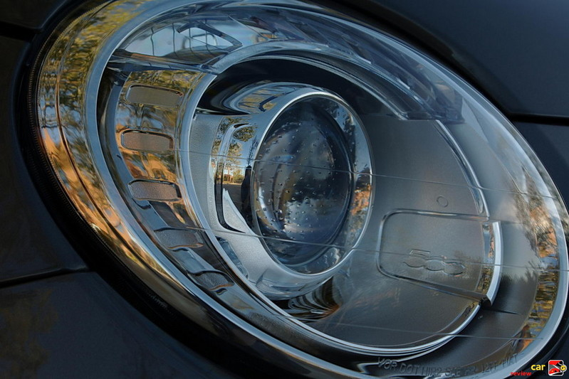 circular, upper halogen projector headlights are combined with the lower on